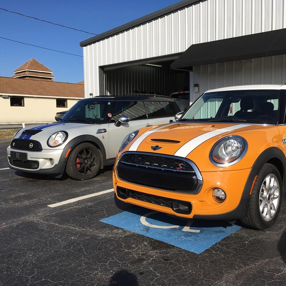 mini coopers in front of heads up automotive